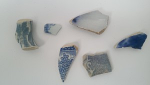 17th century hand-painted delftware on left, plus 19th century tissue printed ware