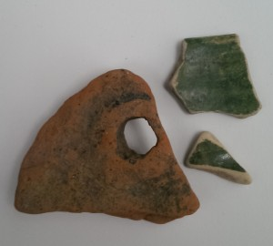 Tudor roof tile and green glazed shards, with throwing rings on reverse  side
